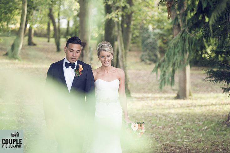 The bride & groom take a walk int he beautiful gardens and forest at Castle Durrow. Weddings at Durrow Castle photographed by Couple Photography.