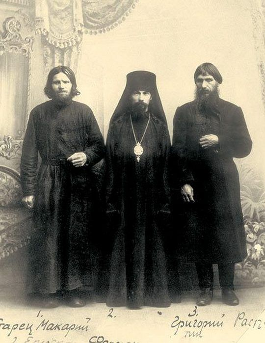 """Grigoriy Rasputin (on the far right) photographed alongside two Orthodox clergyman, mid-1900s. """
