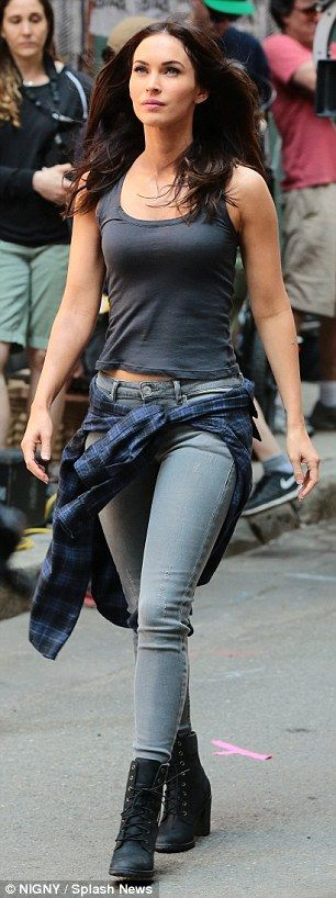 Fashionable journalist: Reprising her Razzie Award-winning role as TV news reporter April O'Neil, Megan's costume included a  tank top that cut short to reveal a hint of her toned midsection, and grey skinny jeans