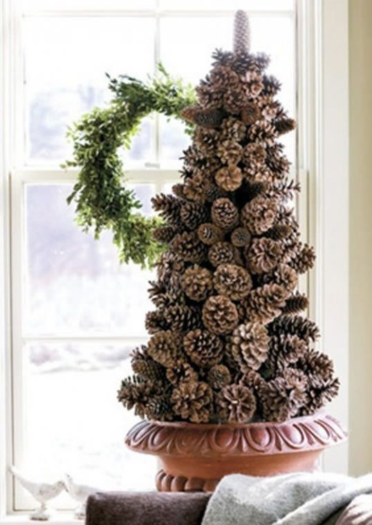 Reuse the pine cones from your Fall decor and make a holiday topiary!