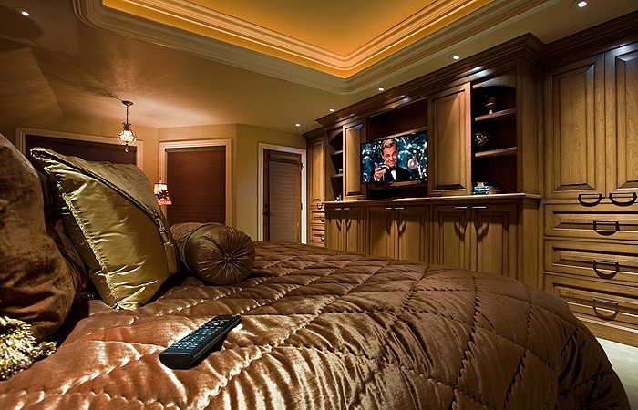 master bedroom with built in entertainment center in custom cabinetry interior design by. Black Bedroom Furniture Sets. Home Design Ideas