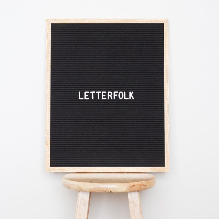 "Letterfolk Writer Oak 16"" x 20"" black felt letter board is the perfect accent piece for any home or business with its striking black felt and light oak frame."