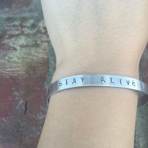 Hand Stamped Twenty One Pilots Bracelet Stay Alive. Each bracelet is uniquely hand made with each order. Bracelets are made with 20G aluminum, and