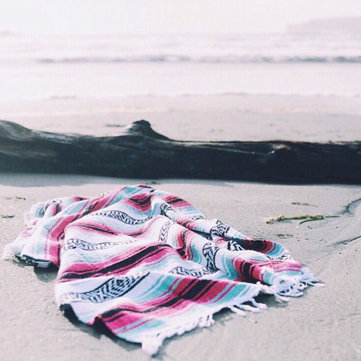 This is an authentic Mexican blanket in beachy pastel colors... perfect for the beach, picnic or as a bright home accent. Blanket colors: Sea foam/mint/turquoise, pink, black & white Measures approxim