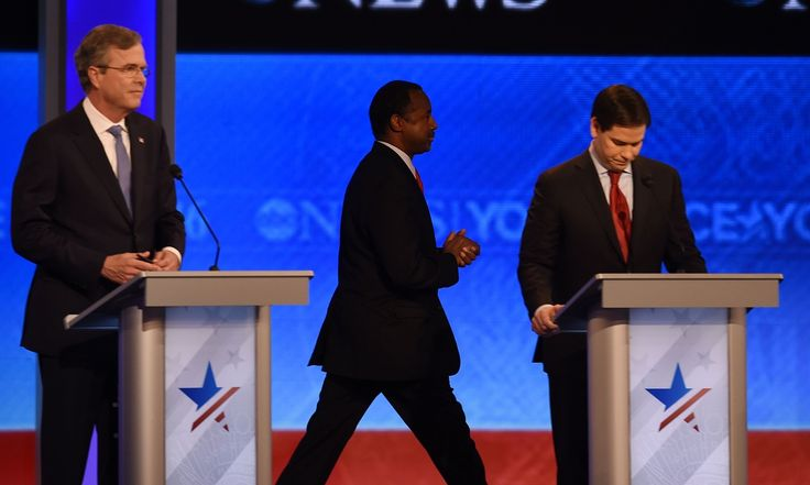 Donald Trump also seemed not to hear his name called as he lined up behind Carson, who idled for over a minute after before stepping onto debate stage