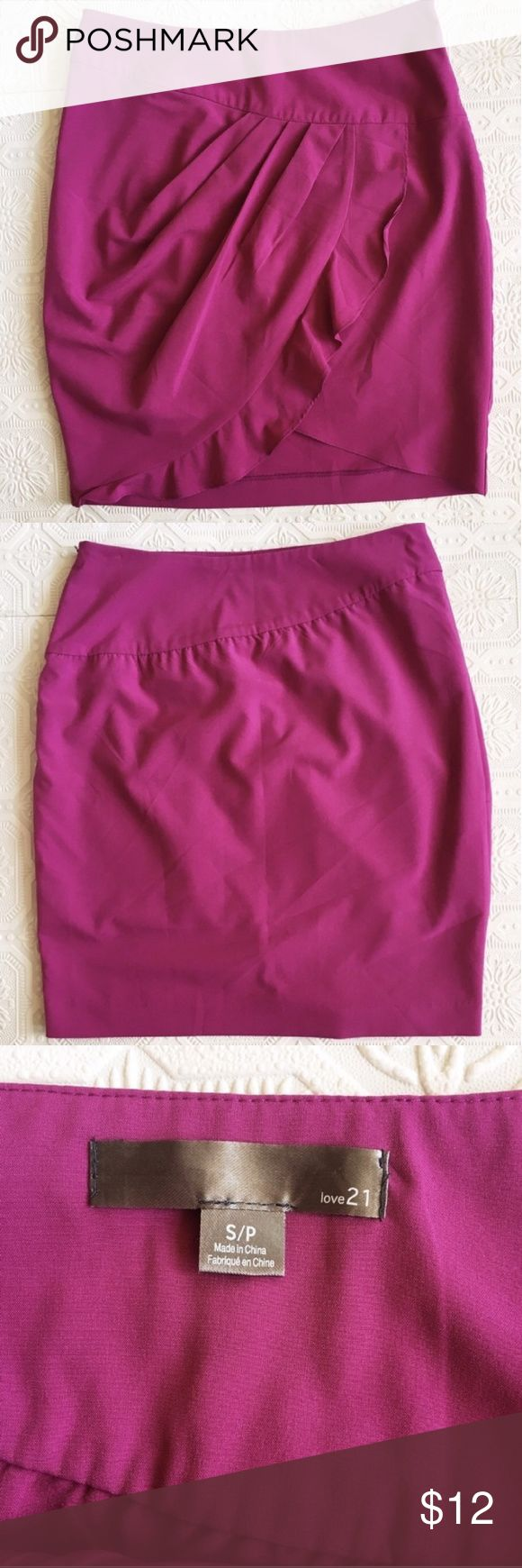 Magenta fuschia tulip skirt Tulip skirt with ruffled wrap. Zipper and hook closure on side. Perfect condition. Tag says size small but this  seems to be a medium.. waist measures 14 inches across, hips 18 inches across, length 19.5 inches. Forever 21 Skirts
