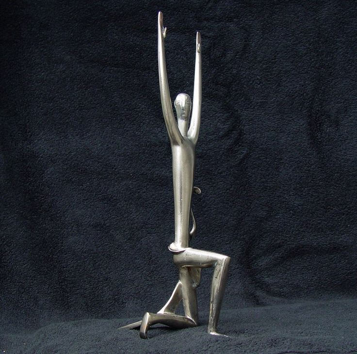 Rare  Art Deco  Hagenauer  Austria Figure Kneeling On One Knee With Arms Raised.   Silvered bronze It stands approximately 13 inches high and is fully  marked on the bottom of the drape. Hagenauer Made in Austria , latest purchase from England