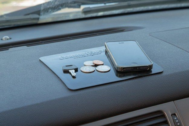 Stick your stuff on your dashboard with Heininger's DashGrip gel pads.   30 Awesomely Useful Car Accessories For Under $100