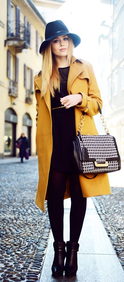 Instantly chic: All black with a colored outer layer. A mustard trench like this is perfect for adding color to a simple look.