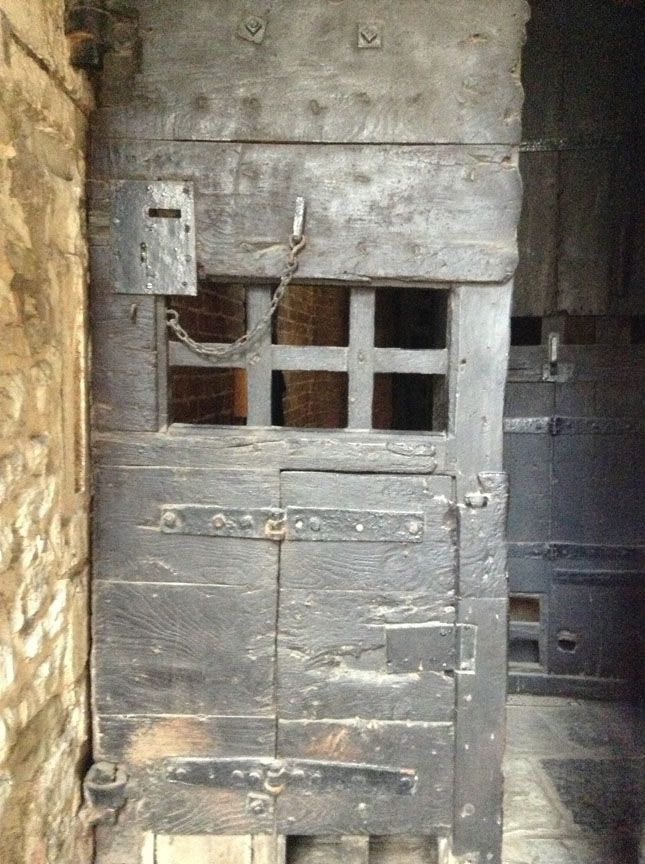 A menacing door, leading to one of the prison chambers in the Tower of London.