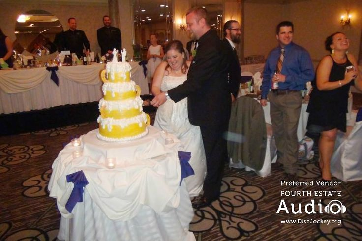 """The bride and groom cut their cake, to Ronnie & Clude's """"Shy Ronnie 2."""" http://www.discjockey.org/real-chicago-wedding-may-2-2015/"""