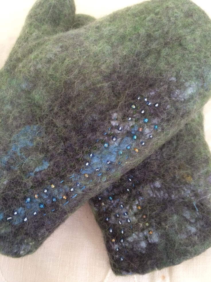 Chilidrens felted wool mittens with stitching and beads.