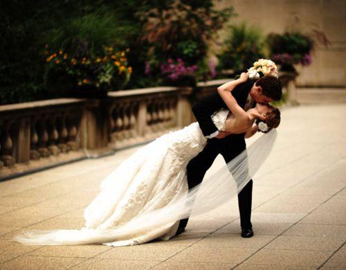 kissing wedding shot