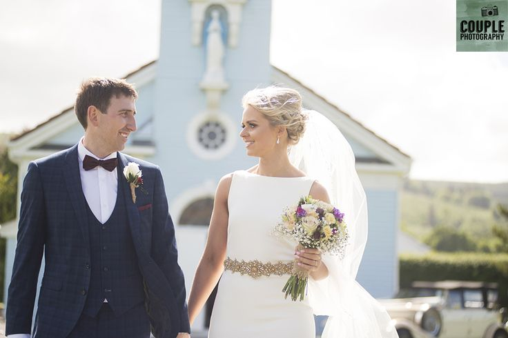 The newlyweds walk from the Lady of the Wayside church in Glenmalure. Wedding at Summerhill House Hotel by Couple Photography.