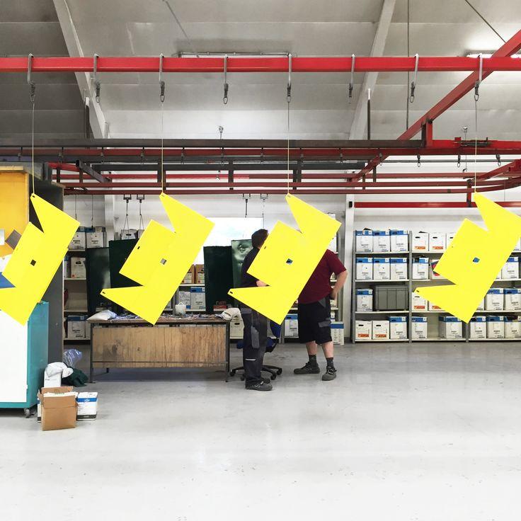 Production of Stilt. A line of yellow Stilt Bookshelves on their way to the oven.   #stilt #bookshelf #production #copenhagen #local #mwa #makerswithagendas #mwadesign #agendadrivendesign #mwagram #nomadicliving #multiuse #minimallogistics