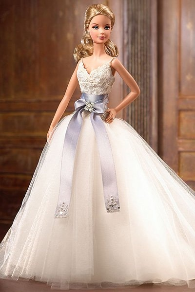 2006: Monique Lhuillier Bride Barbie  Known for her romantic wedding gowns, Lhuiller's Barbie version is no different. The lace bodice with a tulle skirt is accentuated by an oversized sash.