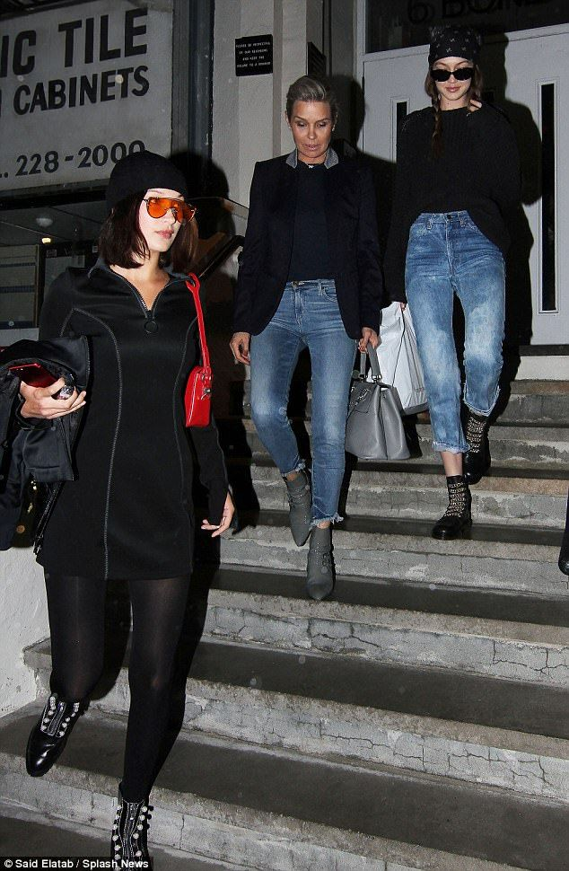 Family outing: The Hadid ladies - Yolanda, 53, with daughters Gigi, 22, and Bella, 20 - proved ready for another photo shoot as they stepped out in NYC on Tuesday