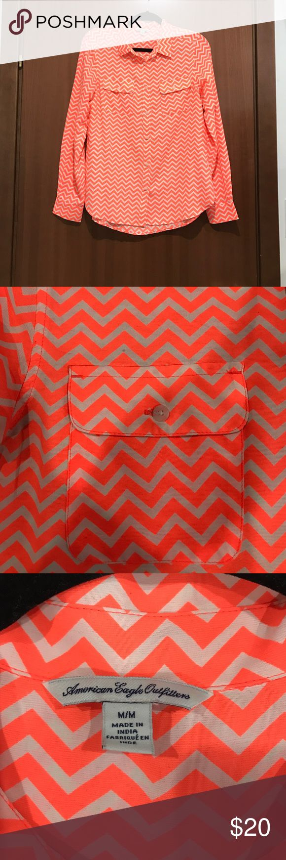 American Eagle chevron blouse This is an American Eagle bright orange and white chevron button down blouse. Size medium. Excellent condition, worn once. American Eagle Outfitters Tops Button Down Shirts