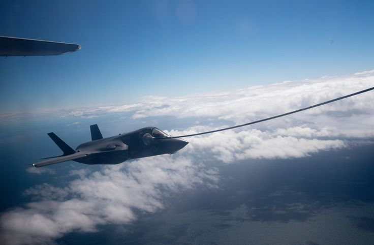 A US Marine Corps F-35B approaches the KC-130J Super Hercules aircraft to refuel.