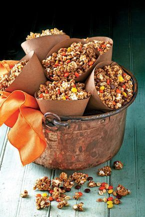 Caramel-Peanut-Popcorn Snack Mix | These easy Halloween party appetizers and drink recipes will be the haunting hit of your party. We've taken all the fear of out of hosting a gracious Halloween party. In fact, we've come up with Halloween party appetizers and Halloween finger foods that are so easy you'll have your guests spooked into thinking that you worked all day in the kitchen on creative Halloween-themed foods. With our easy Halloween finger foods, you'll have plenty of time to spend…
