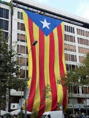 You might see this Catalan flag in Barcelona. This one is so big, it's hard to miss!