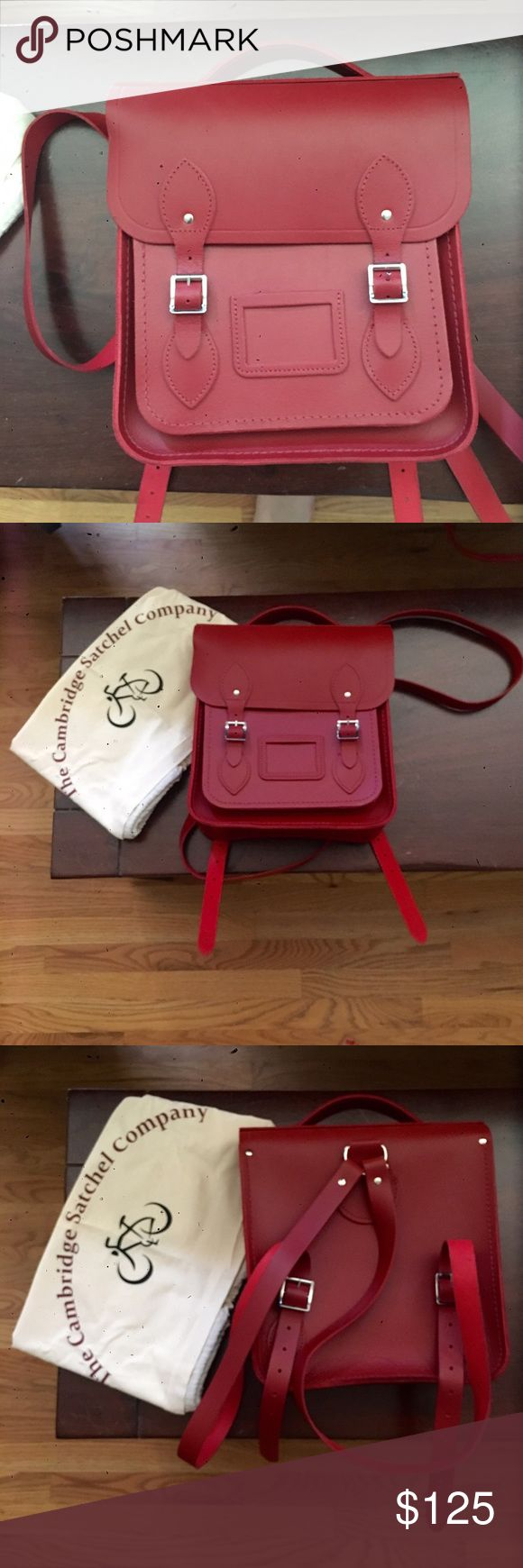 ON SALE!Cambridge Satchel Small Red Backpack NWOT Small backpack, enough to hold iPad mini, wallet and makeup. Great pop to any outfit!!!!Height: 10.75in / 27cm Length: 11in / 28cm Depth: 3.25in / 8cm Cambridge Satchel Bags Backpacks