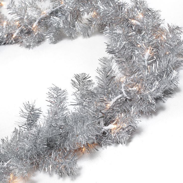 Classic Silver 9 ft. Pre-lit Garland - Have a shiny happy holiday with the Classic Silver 9 ft. Pre-lit Garland. Its dazzling silver needles reflect the glow of Christmas lights to fill you...