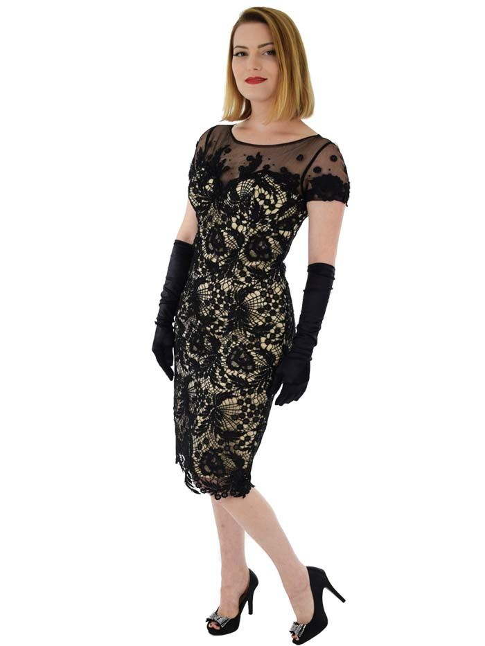 Curve hugging beaded black lace cocktail dress with illusion net bodice will have you feeling like Marilyn when you sashay into your next holiday party.