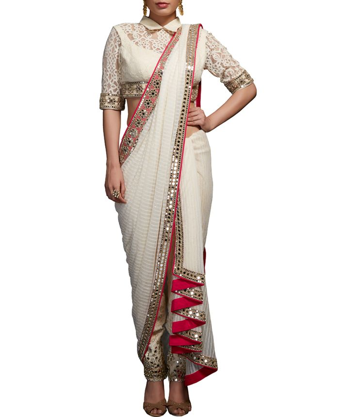 This ensemble comprises of off-white embellished blouse with mirror and pearl embroidery, matching thick lace fitted pants with mirror embellishment and self stripe saree drape with mirror border.