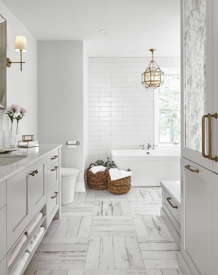 An awkwardly shaped walk-in closet, built-in corner tub, separate shower and dividing wall made this washroom unnecessarily cramped and uninviting.