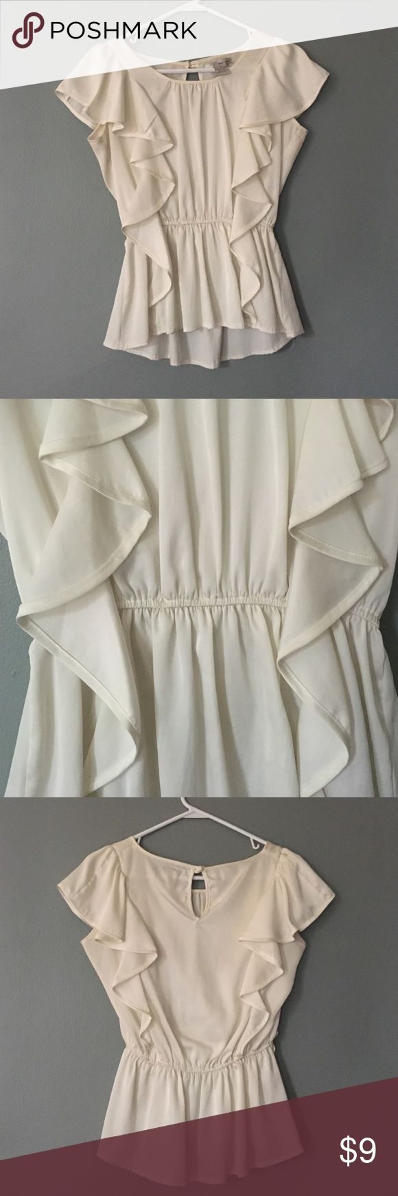Cream short sleeved blouse with ruffles Very versatile top! Cream short sleeved blouse with ruffles and a cinched waist. Tops Blouses
