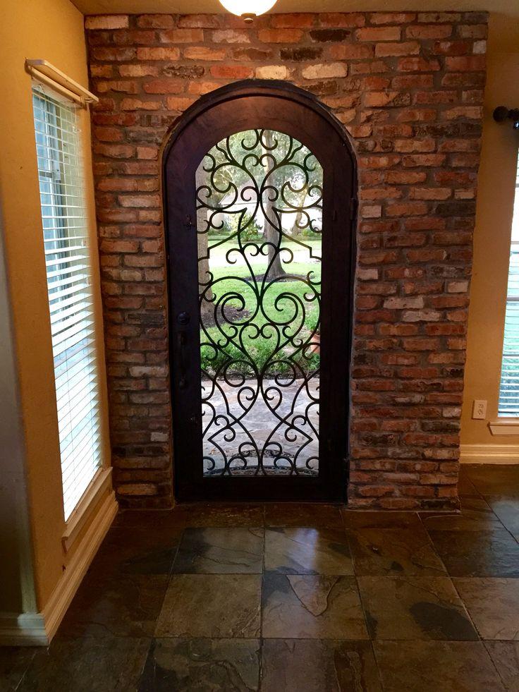 Chicago brick interior with wrought iron heart door!