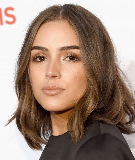Olivia Culpo's chestnut brown hair, golden eye makeup and nude lipstick make for an understated beauty look: