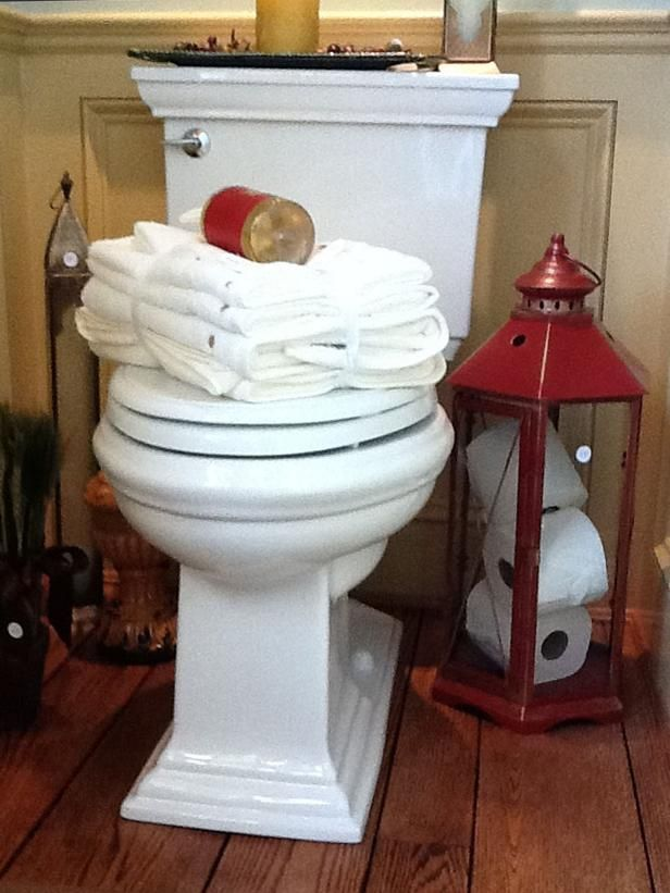 Big Ideas for Small Bathroom Storage: This red lantern was too pretty to throw out. So interior designer Jill Valeri of The Welcome Home Interior Design Solutions polished it up and found that it looked good enough to display in her bathroom. Bonus? It can even hold a few extra rolls of toilet tissue. From DIYnetwork.com