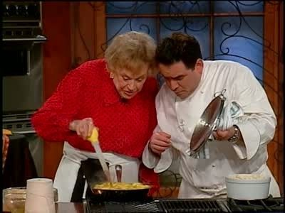 Emeril Lagasse and guest Julia Child combine ingredients for her famous upside down apple tart also known as apple tarte tatin.