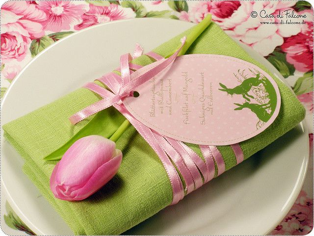Gorgeous table setting for a reception or shower - green napkin, pink ribbon & tulip.