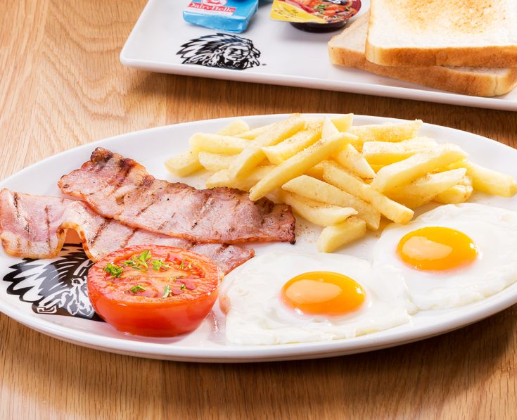 Unreal Breakfast: 2 fried eggs, 2 grilled rashers of bacon & fried tomato. Served with chips, 2 slices of toast, jam & butter. https://www.spur.co.za/menu/breakfast/