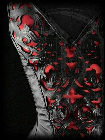 Corset---this is the one. Black leather cutaway design gothic on red. Sexy goth.