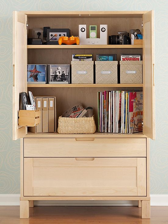 No more searching around the house for your favorite movies and magazines. This armoire relies on labeled boxes to corral entertainment essentials. Using coordinating baskets is a stylish and strategic way to keep games, CDs, and DVDs organized.: Entertainment Central, Dining Rooms, Living Rooms, Organizations Ideas, Storage Bins, Creative Organizations, Hidden Offices Storage, Revamp Armoires, Entertainment Center