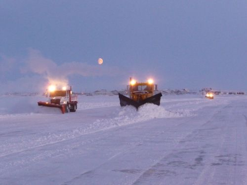 Snowplows helping to build the ice road.