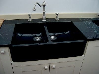 Black Double Kitchen Sink- farmhouse style black sink against white cabinets.
