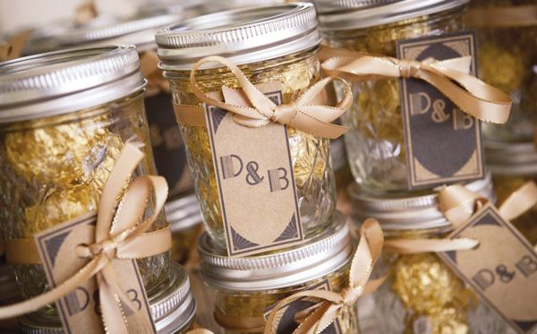 Wedding Favors? I'm not sure if I want to do this, but it's just super cute! Little mason jars with chocolates in them.