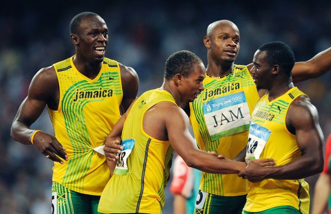 In this Friday, Aug. 22, 2008 file photo, Jamaica's gold medal winning relay team, from left, Usain Bolt, Michael Frater, Asafa Powell and Nesta Carter celebrate after the men's 4x100-metre relay final during the athletics competitions in the National Stadium at the Beijing 2008 Olympics in Beijing. Usain Bolt has been stripped of one of his nine Olympic gold medals, Wednesday, Jan. 25, 2017, in a doping case involving teammate Nesta Carter. (AP Photo/Mark J. Terrill, File)