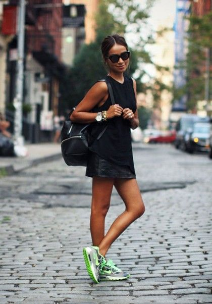 Show some leg with a black leather mini skirt and sneakers. Add a trendy backpack and oversized watch to further play up the outfit's sporty vibe.