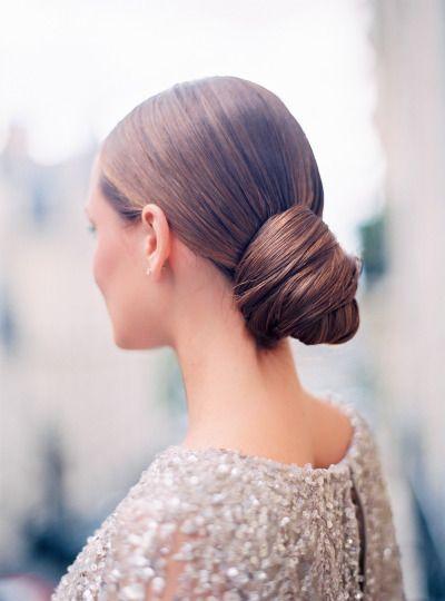 A sleek wrap bun: http://www.stylemepretty.com/destination-weddings/2015/07/02/romantic-haute-couture-wedding-inspiration-in-paris/   Photography: Le Secret D'Audrey - http://www.lesecretdaudrey.com/