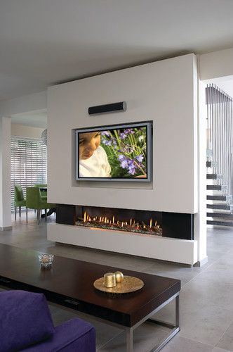 Fireplace and tv....This low and wide fireplace allows tv to be placed at a better level for viewing than a traditional fireplace