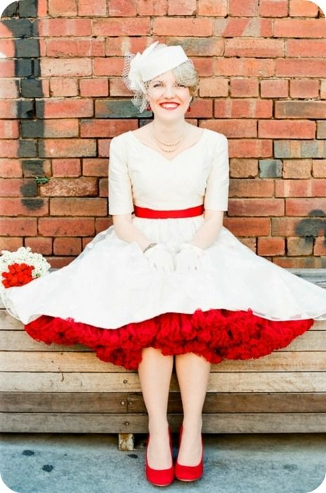 colored petticoats!! there are so many possibilities--you could wear a white one for the ceremony and swap in a red one for the reception (maybe the bridesmaids, too?-in a different color, of course)