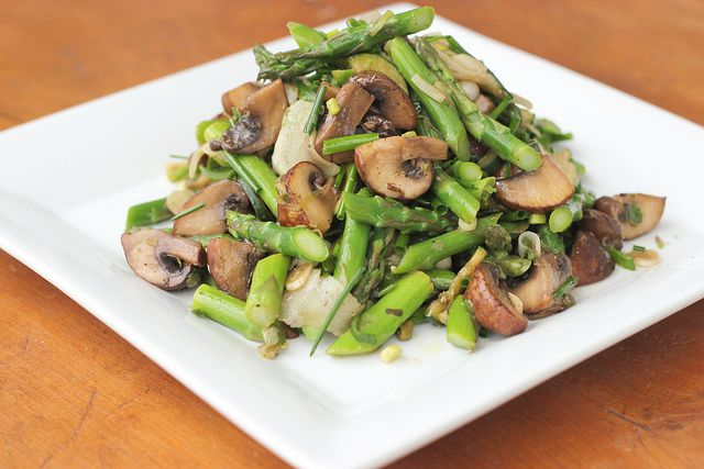 MARINATED MUSHROOMS AND ASPARAGUS SALAD 1 pound of mushrooms (crimini or whatever is available), quartered  1 pound asparagus, bottom two inches cut off  1 turnip, waxy skin removed and then shaved thin using a vegetable peeler  1 bunch scallions chopped large  5 cloves garlic, chopped  1 small zucchini, quartered lengthwise and sliced thin  a small bunch chives, cut one inch long  2 tablespoons capers  2 tablespoons red wine vinegar  2 tablespoons olive oil