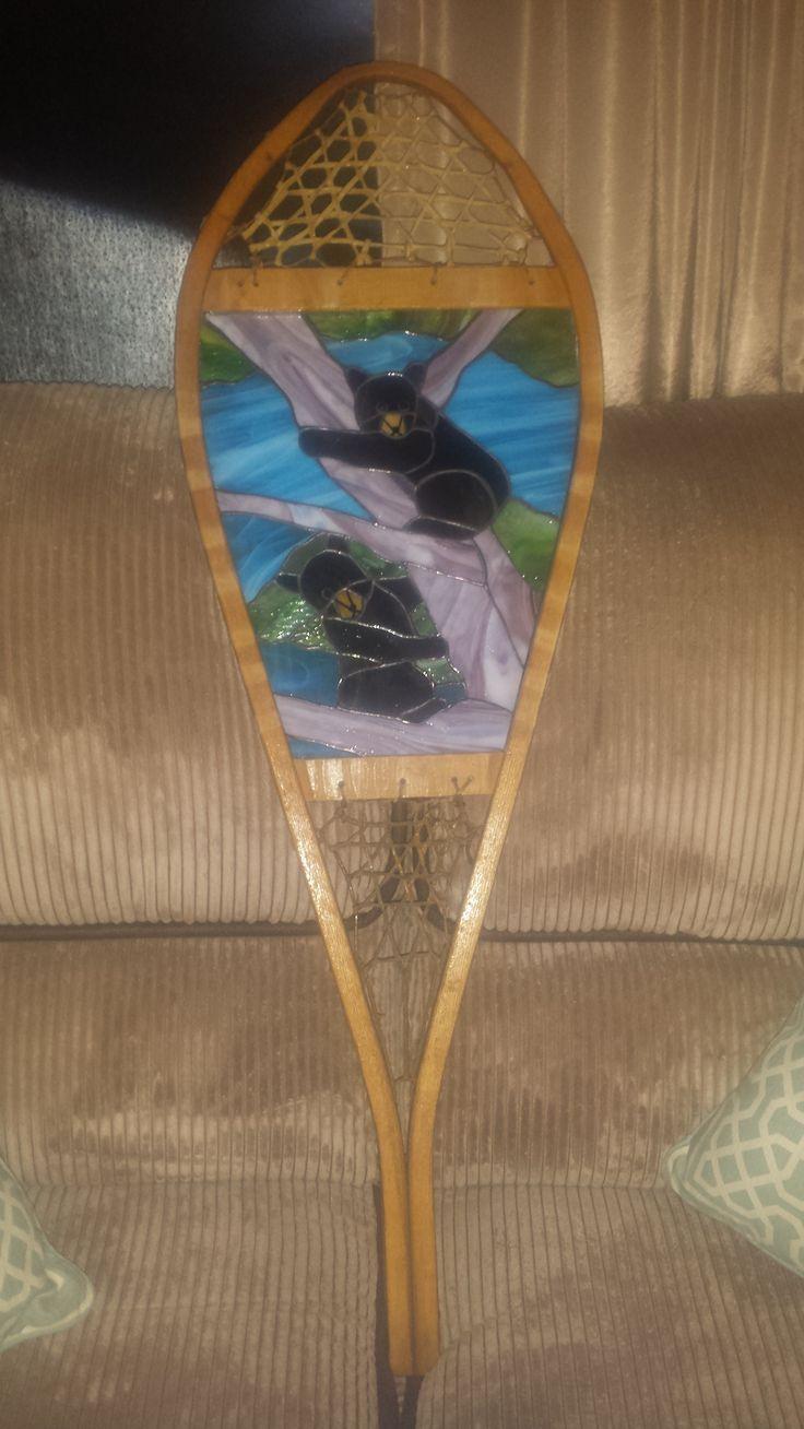 Baby black bear panel framed in antique snowshoe
