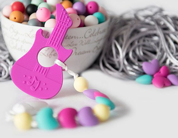 Unique baby gift idea Silicone teething toy Pink guitar